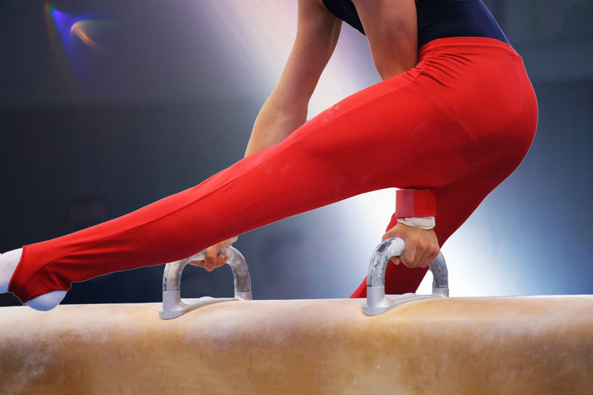 Detailed view of a gymnastic on the pommel horse